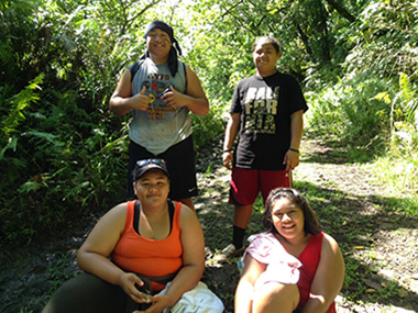 Hiker group poses along the Mount 'Alava Trail.