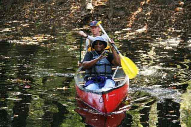 Paddlers enjoy the sites and sounds of wilderness along Cedar Creek