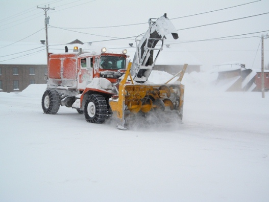 A snowblower the size of a large truck clears a street in Calumet.