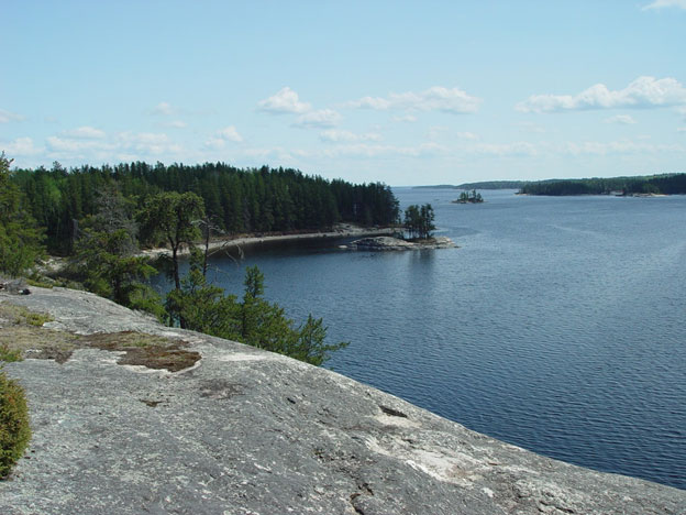 Overlooking the blue waters of Rainy Lake from a granite bluff