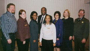 Group photo of 8 people from Network to Freedom launch event in 2000.