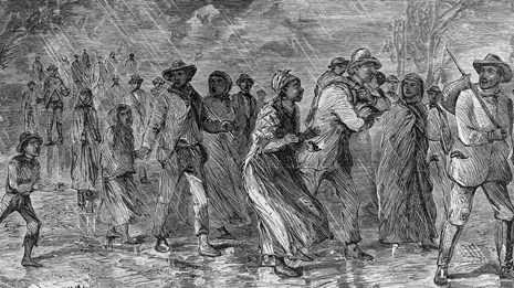 An illustration of freedom seekers escaping on the Underground Railroad.