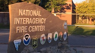 Sign for the National Interagency Fire Center with bureau/agency logos.