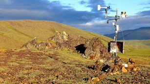 Weather monitoring equipment set up in national park.