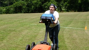 Archeologist pushes Ground Penetrating Radar unit