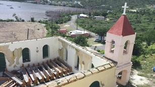St. John Moravian church pictured without roof overlooking bay.