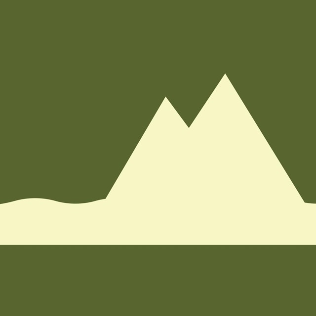 Green background with white icon of a mountain.