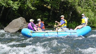 Four rafters in whitewater section