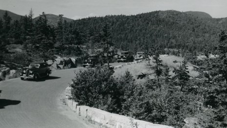 Historic photo of cars on a scenic road