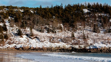Snow and ice on cliffs along a beach