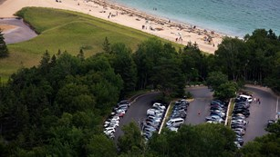 Aerial view of Sand Beach and parking area as seen from the Beehive Trail