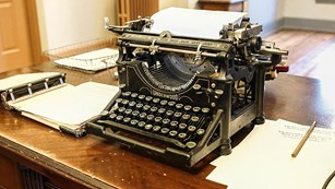 historic typewriter on a wooden desk