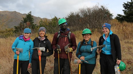 a group of trail crew volunteers pose for a photo
