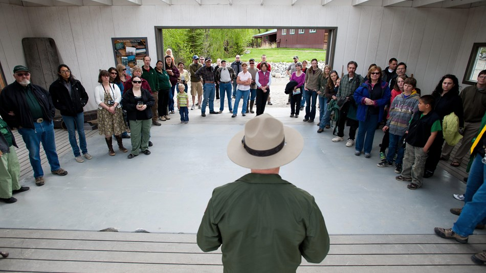 an NPS ranger speaks to a group of community members