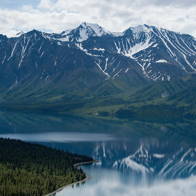 mountains in Lake Clark National Park reflected in calm waters