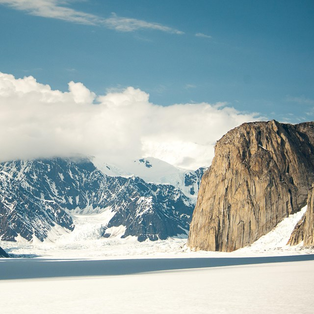 a vast, level glacier surrounded by craggy mountains