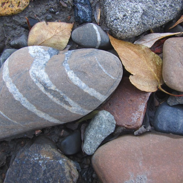 closeup of a variety of round rocks