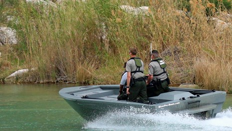 Park Rangers patrolling a river canyon