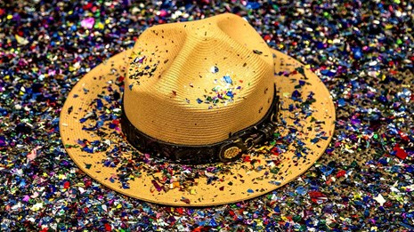 NPS straw ranger hat covered in multicolored confetti