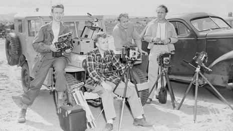 Photograph at the Windows Section is 4 men sitting on two vehicles with cameras on tripods.