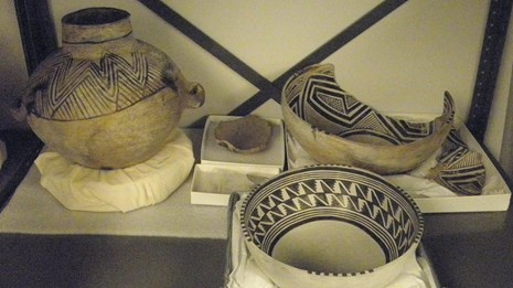 Photograph of an archeology collection in a museum cabinet.