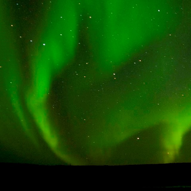 The northern lights dance across an Arctic sky.