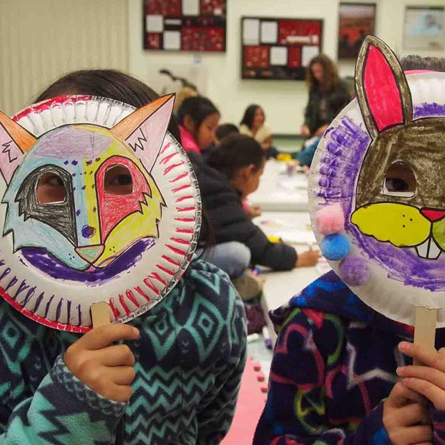 Two kids in animal masks they made.
