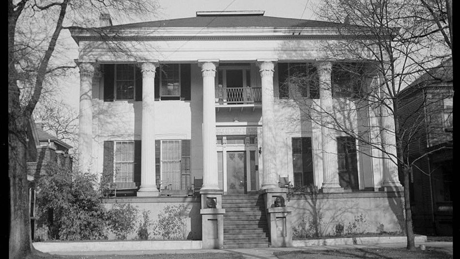 Exterior of large two-story house with Greek-Revival pillars. Library of Congress.