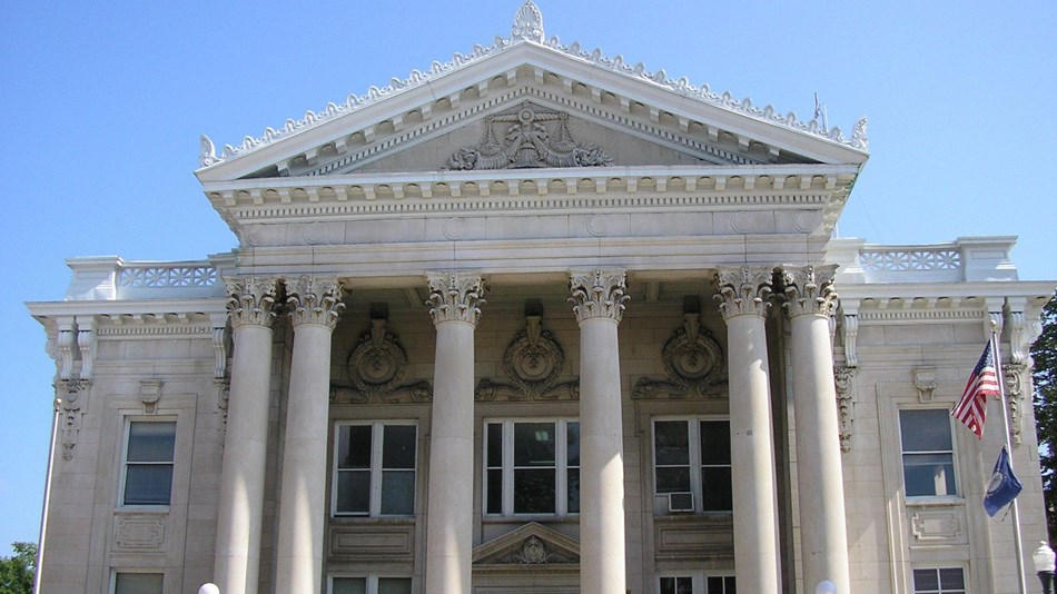 Stone courthouse with Greco-Roman columns.