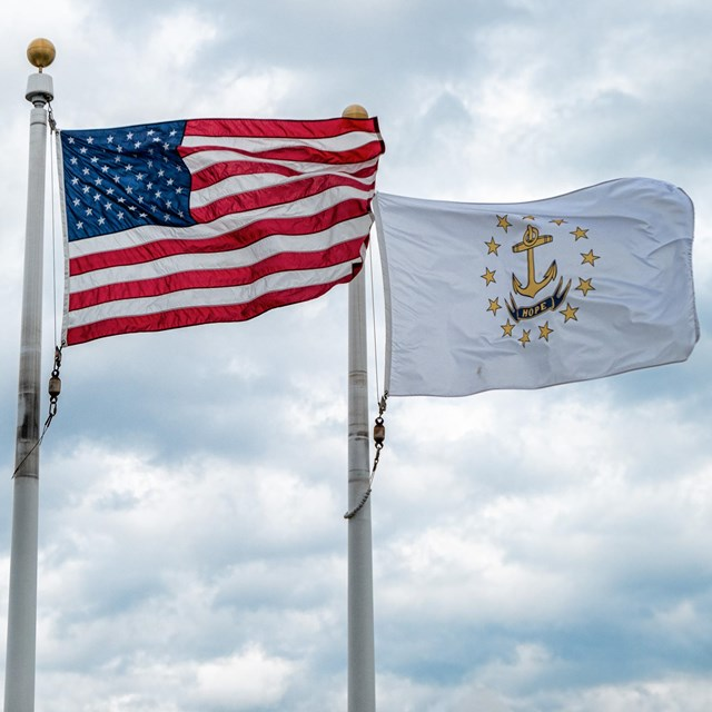 The flag of the city of Providence, the American flag, and the flag of Rhode Island