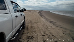 view looking north on Assateague beach from behind an over sand vehicle (OSV)