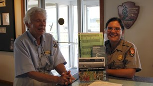 NPS staff and various brochures at the visitor center desk