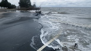 photo of road damage to Bayside picnic area parking lot from Hurricane Sandy.
