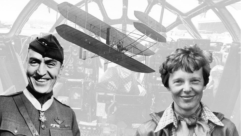 A man and a woman pose in front of a plane cockpit with an early airplane in the background