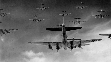 Several planes in the sky, flying in formation
