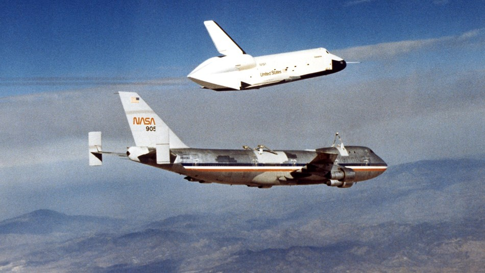 The space shuttle lifts off of the back of a large plane