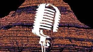 stylized multicolor Badlands formations with a superimposed image of a white microphone.