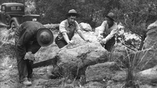 CCC workers cut a rock during construction