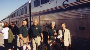Trails and Rails volunteers wait to board the Southwest Chief train