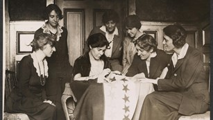 Party Activists watch founder Alice Paul sew a Star onto Ratification Flag