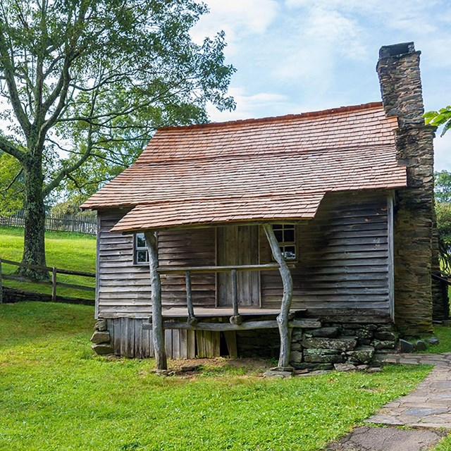 historic Brinegar cabin in early summer
