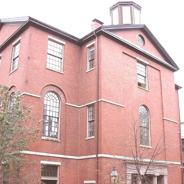 three story red brick building
