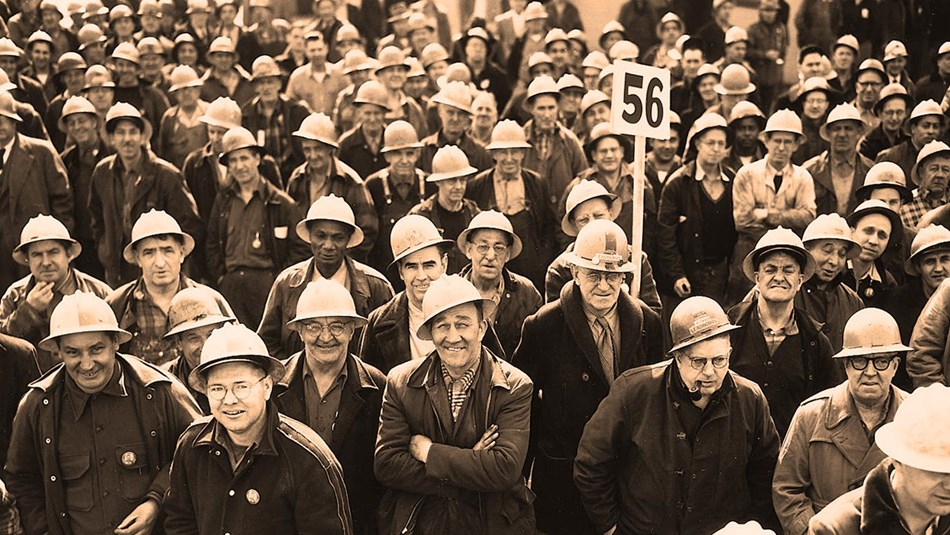 Photograph of a large gathering of navy yard workers wearing hard hats