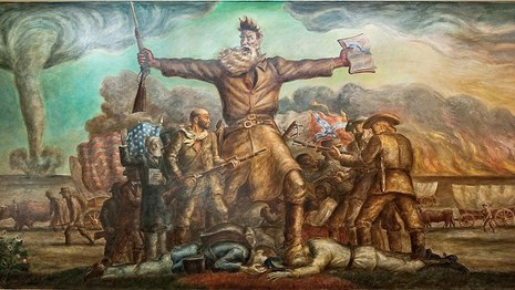 John Brown in front of bloodshed with a bible in one hand and a rifle in the other.