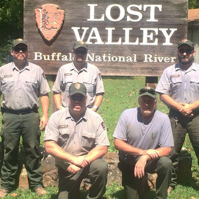 A group of maintenance workers pose at the Lost Valley Trailhead.