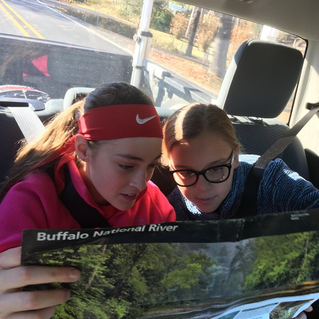 Two students view a Buffalo River map.