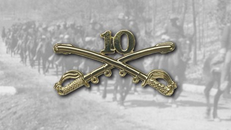 The 10th cavalry pin over top of a photo of mounted soldier