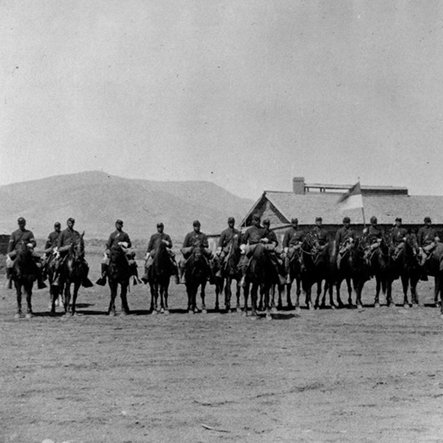 Several african american mounted soldiers in formation