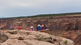 Visitors enjoy views of the canyon from the overlooks