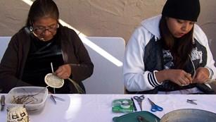 two American Indian basket weavers at work